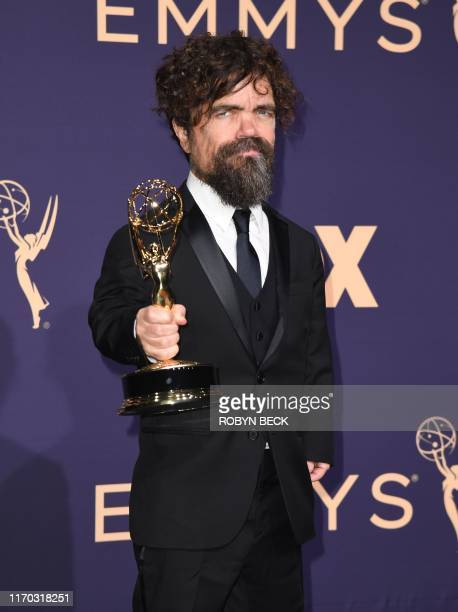 TOPSHOT US actor Peter Dinklage poses with the Emmy for Outstanding Supporting Actor in a Drama Series for Game of Thrones during the 71st Emmy...