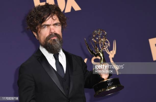 "Actor Peter Dinklage poses with the Emmy for Outstanding Supporting Actor in a Drama Series for ""Game of Thrones"" during the 71st Emmy Awards at the..."