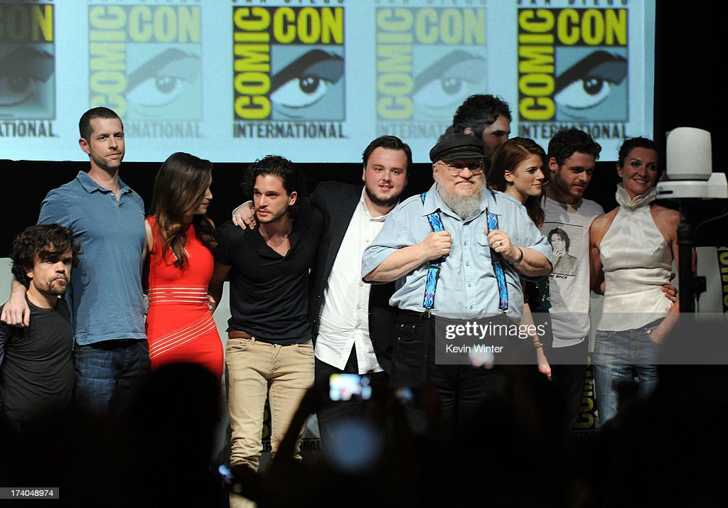 Actor Peter Dinklage, writer/producer D.B. Weiss, actors Emilia Clarke, Kit Harington, John Bradley, Jason Momoa, author/executive producer George R.R. Martin, actors Rose Leslie, Richard Madden and Michelle Fairley onstage during the 'Game Of Thrones' panel during Comic-Con International 2013 at San Diego Convention Center on July 19, 2013 in San Diego, California.