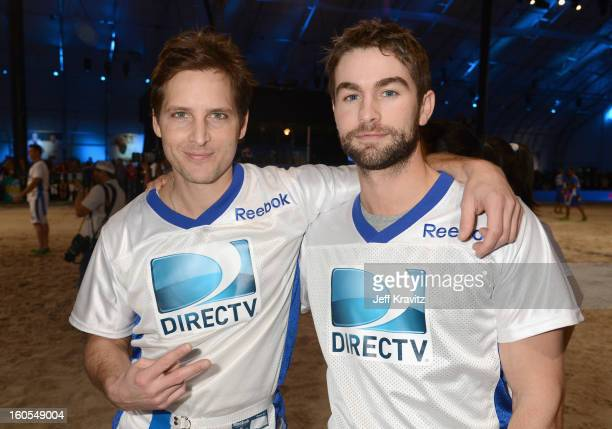 Actor Peter Facinelli and actor Chace Crawford attend DIRECTV'S 7th Annual Celebrity Beach Bowl at DTV SuperFan Stadium at Mardi Gras World on...