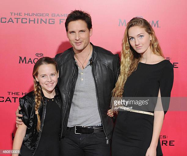Actor Peter Facinelli and daughters Luca Bella Facinelli and Lola Ray Facinelli arrive at the Los Angeles Premiere The Hunger Games Catching Fire at...