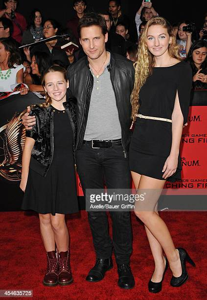 Actor Peter Facinelli and daughters Luca Bella Facinelli and Lola Ray Facinelli arrive at the Los Angeles Premiere of 'The Hunger Games Catching...