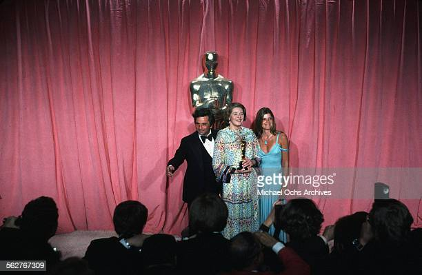Actor Peter Falk Actress Ingrid Bergman and actress Katharine Ross pose backstage after the Best Supporting Actress award during the 47th Academy...