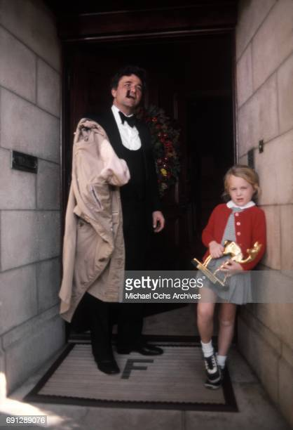 Actor Peter Falk and his daughter Katherine on the set of his TV show Columbo on December 16 1975 in Los Angeles California