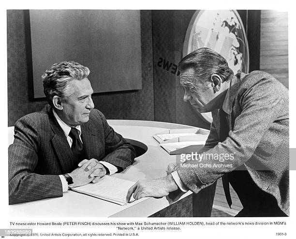 Actor Peter Finch and William Holden on set of the MGM movie Network in 1976