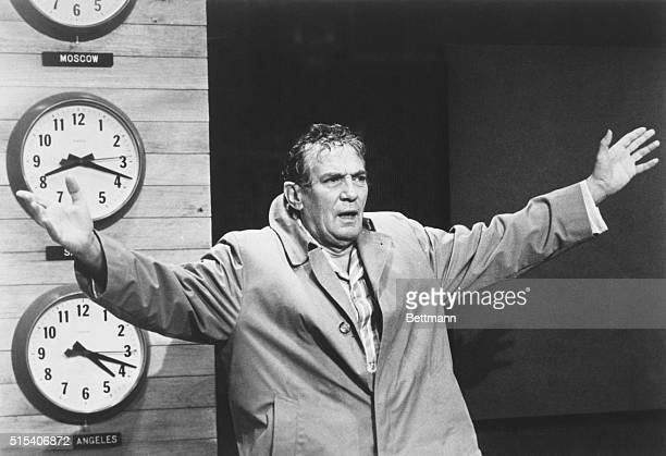Actor Peter Finch as television news anchor Howard Beale exhorts his television followers to revolt and express themselves in this scene from the...
