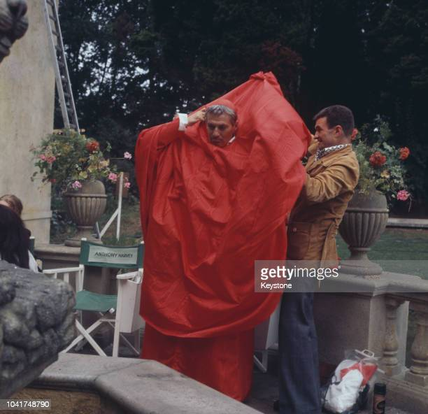 Actor Peter Finch filming 'The Abdication' in which he plays Cardinal Azzolino circa 1974 Behind him is the chair of the film's director Anthony...