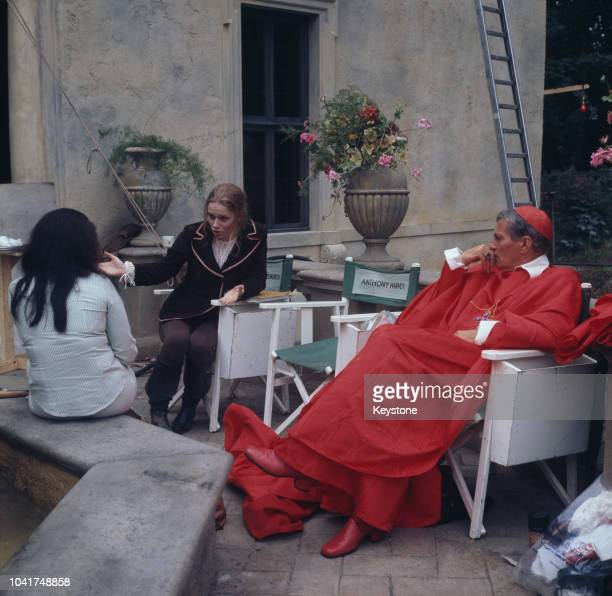 Actor Peter Finch filming 'The Abdication' in which he plays Cardinal Azzolino circa 1974 Next to him is the chair of the film's director Anthony...