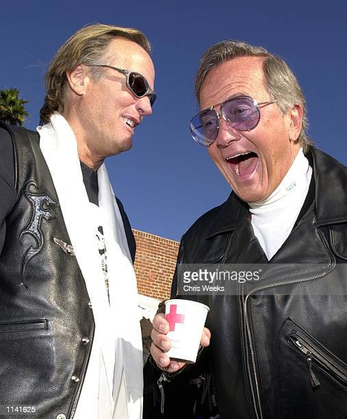 Actor Peter Fonda left and performer Pat Boone arrive at the 17th Annual Love Ride November 12 2000 in Glendale CA