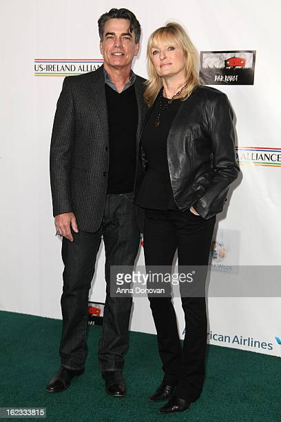 Actor Peter Gallagher and producer Paula Wildash arrives to the USIreland Alliance preAcademy Awards gala at Bad Robot on February 21 2013 in Santa...