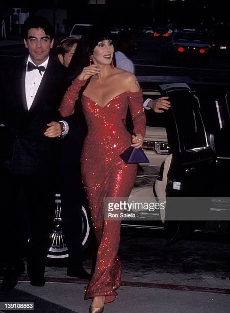 Actor Peter Gallagher and singer/actress Cher arrive for the filming of The Player on July 20 1991 at the Los Angeles County Museum of Art in Los...