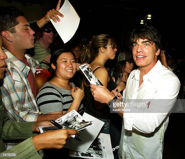Actor Peter Gallagher signs autographs at a viewing party for Fox TV's The OC at Sharkeez Resturant on September 9 2003 in Hermosa Beach California