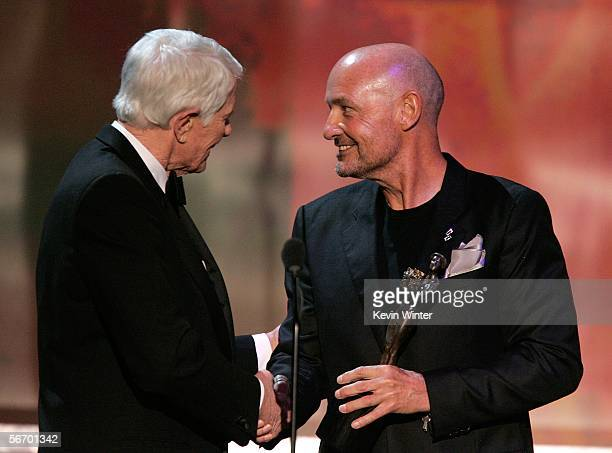 Actor Peter Graves presents Terry O'Quinn with the Outstanding Ensemble in a Drama Series onstage during the 12th Annual Screen Actors Guild Awards...