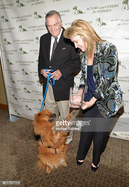 Actor Peter Marshall and Laurie Marshall and their service dog Teddy Bear attend Actors And Others For Animals' Joy To The Animals luncheon...