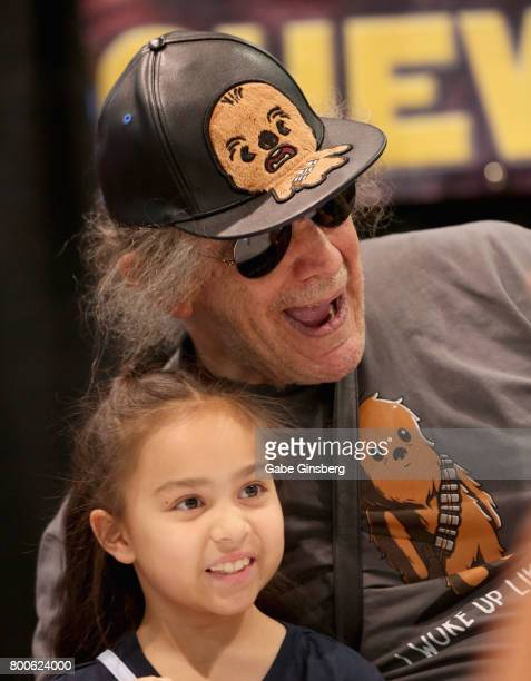 Actor Peter Mayhew poses with an attendee during the Amazing Las Vegas Comic Con at the Las Vegas Convention Center on June 24 2017 in Las Vegas...