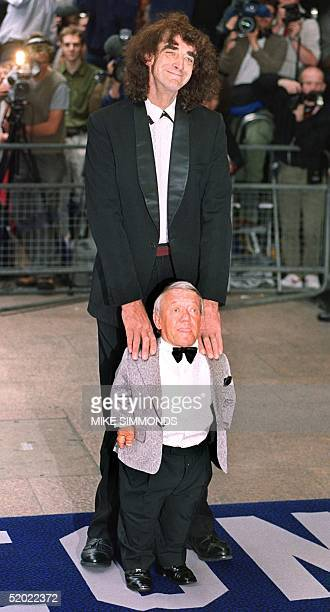 Actor Peter Mayhew who played Chewbaca the Wookey in the first three films poses with Kenny Baker who plays R2D2 in both the older films as well as...