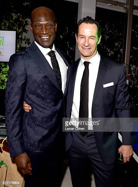 Actor Peter Mensah and photographer Sebastian Copeland attend Global Green USA's 13th annual preOscar party at Mr C Beverly Hills on February 24 2016...