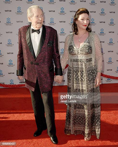 Actor Peter O'Toole and guest attend the TCM Classic Film Festival opening night gala and world premiere of the newly restored 'An American In Paris'...