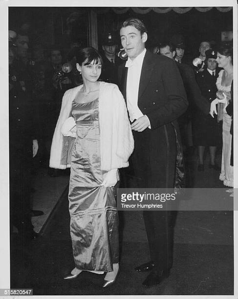Actor Peter O'Toole and guest, attending the Royal Film Performance at Odeon, Leicester Square, London, February 15th 1965.