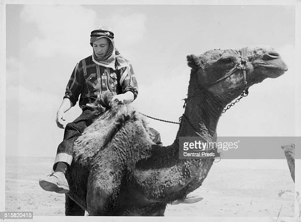 Actor Peter O'Toole in costume and riding a camel on the set of the film 'Lawrence of Arabia' Jordan April 12th 1961