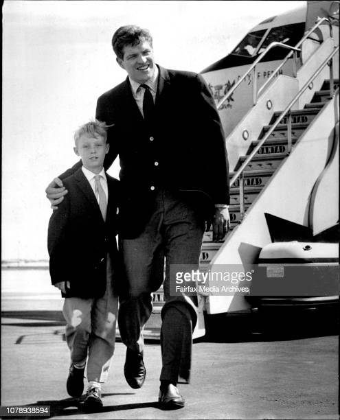 Actor, Peter Palmer with Ian Willie at Sydney Airport. Hefty Peter Palmer-he's better known as Li'l Abner Yokum-reckons Australian footballers would...