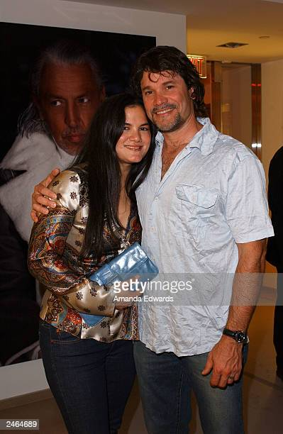 Actor Peter Reckell poses with singer Kelly Moneymaker at the grand reopening party of the Hugo Boss Rodeo store on September 4 2003 in Beverly Hills...