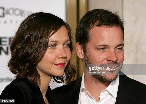 Actor Peter Sarsgaard and actress Maggie Gyllenhaal arrive at the premiere of Brokeback Mountain at the Mann National Theater on November 29 2005 in...