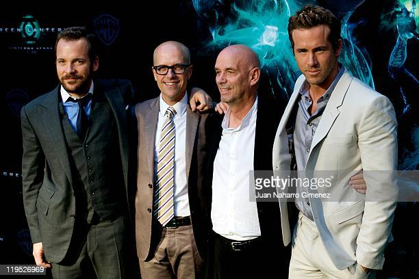 Actor Peter Sarsgaard producer Donal de Line director Martin Campbell and Ryan Reynolds attend the Green Lantern premiere at Callao Cinema on July 21...