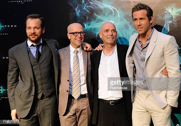 Actor Peter Sarsgaard producer Donald De Line director Martin Campbell and actor Ryan Reynolds attend the premiere of Green Lantern at Callao Cinema...