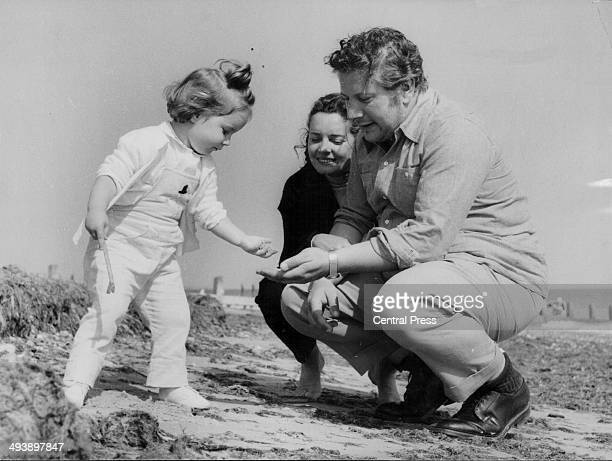 Actor Peter Ustinov, with his wife Suzanne Cloutier and daughter Andrea-Claudia, on the beach in Clymping, Sussex, August 17th 1961.