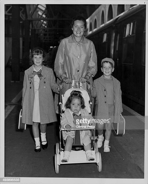 Actor Peter Ustinov's wife Suzanne with their children Pavla, Andrea Claudia and Igor, arriving at Victoria Train Station from Switzerland, July 12th...