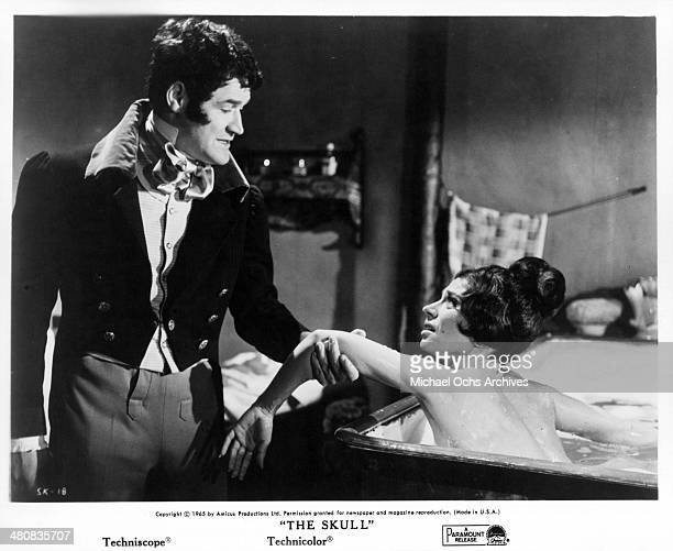 Actor Peter Woodthorpe and actress April Olrich in a scene from the movie 'The Skull' circa 1965