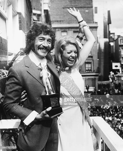Actor Peter Wyngarde being presented with the 'John Stephen Fashion Award' by Miss Radio Luxembourg Anne Challis for FAB 208 Magazine in Carnaby...