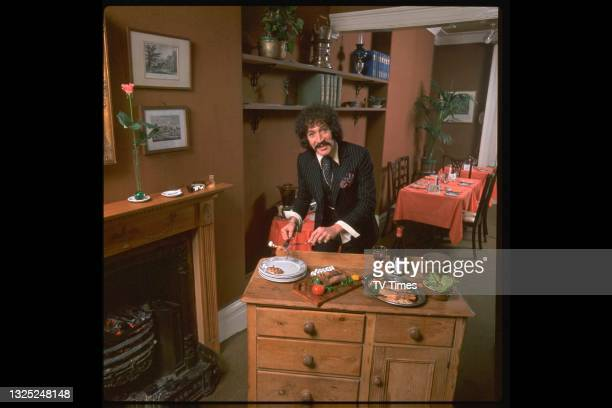 Actor Peter Wyngarde, known for his role as Jason King in spy adventure series Department S, photographed serving a meal at home, circa 1972.