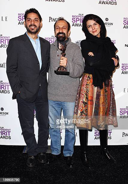 Actor Peyman Maadi Asghar Farhadi and actress Leila Hatami pose with the Best International Award in the press room at the 2012 Film Independent...