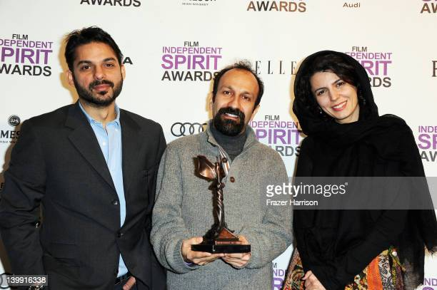 Actor Peyman Maadi director Asghar Farhadi and actress Leila Hatami pose with the award for Best International for 'A Separationt' in the press room...