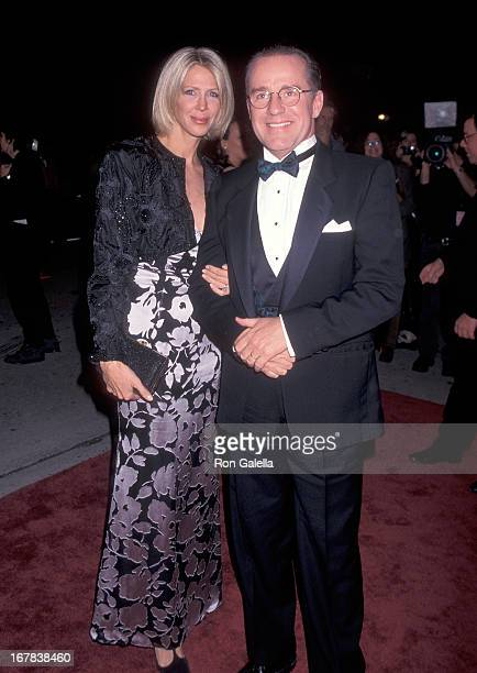 Actor Phil Hartman and wife Brynn attend the 10th Annual American Comedy Awards on February 11 1996 at the Shrine Auditorium in Los Angeles California