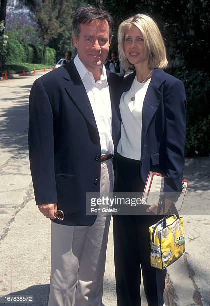 Actor Phil Hartman and wife Brynn attend the Picnic on the Green Benefit for the Children's Health Environmental Coalition on May 11 1996 at the...