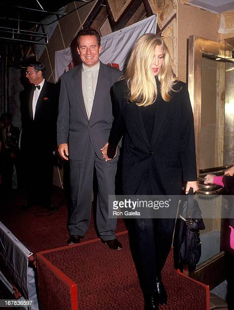 Actor Phil Hartman and wife Brynn attend the Planet Hollywood Grand Opening Celebration on October 22 1991 at Planet Hollywood 140 West 57th Street...