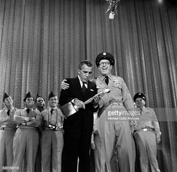 Actor Phil Silvers as Col Bilko and troops award Ed Sullivan with a Goofy Trophy on the 'Toast of the Town' show hosted by Ed Sullivan at the Maxine...