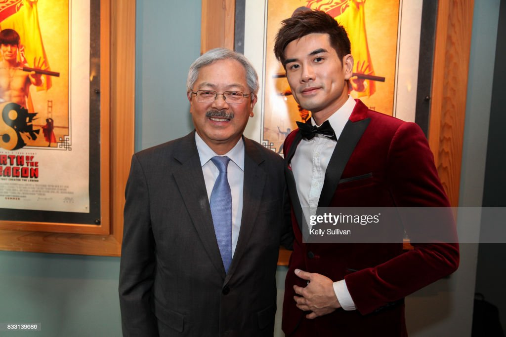 Actor Philip Ng (R) poses for a photo with San Francisco Mayor Ed Lee (L) at a special screening of BH Tilt & WWE Studios' 'Birth of the Dragon' at the AMC Dine-In Kabuki 8 theater on August 16, 2017 in San Francisco, California.