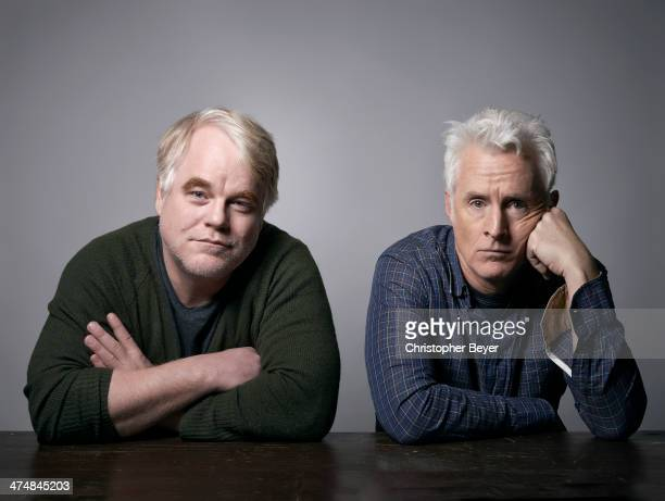 Actor Philip Seymour Hoffman and actor/director John Slattery are photographed for Entertainment Weekly Magazine on January 25, 2014 in Park City,...