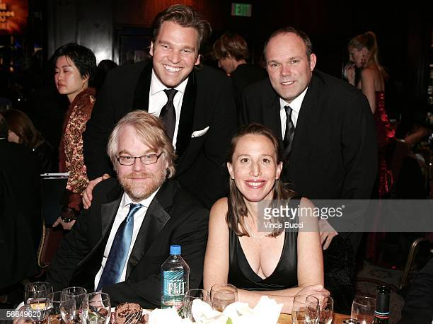 Actor Philip Seymour Hoffman and Capote producers Michael Ohoven Caroline Baron and William Vince attend the 2006 Producers Guild awards held at the...