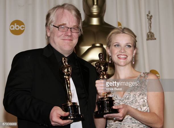 Actor Philip Seymour Hoffman poses with his Oscar statuette for Best Actor in a Leading Role for Capote and actress Reese Witherspoon poses with her...