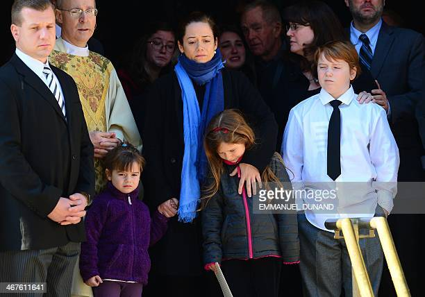 US actor Philip Seymour Hoffman's estranged partner Mimi O'Donnell with their children Cooper Hoffman Willa Hoffman and Tallulah Hoffman watch his...