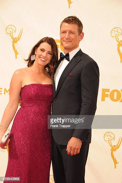 Actor Philip Winchester and wife Megan Marie Coughlin arrive at the 67th Annual Primetime Emmy Awards held at the Microsoft Theater