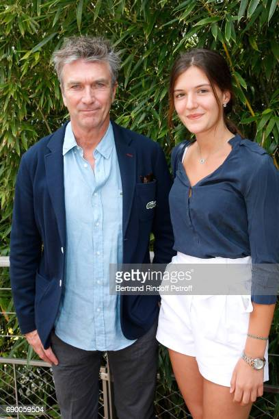 Actor Philippe Caroit and his daughter Blanche attend the 2017 French Tennis Open Day Three at Roland Garros on May 30 2017 in Paris France