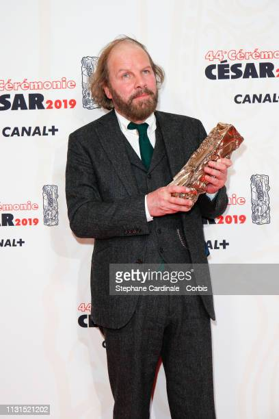 Actor Philippe Katerine winner of the award for Best Supporting Actor for 'Le Grand Bain' poses in the press room during the 44th Cesar Awards...