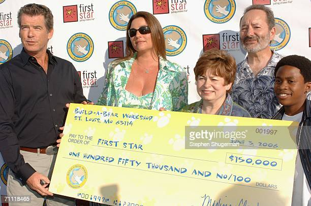 Actor Pierce Brosnan actor Keely Shaye Smith First Star's Maxine Clark First Star's Peter Samuelson and actor Malcolm David Keeley hold a donation...