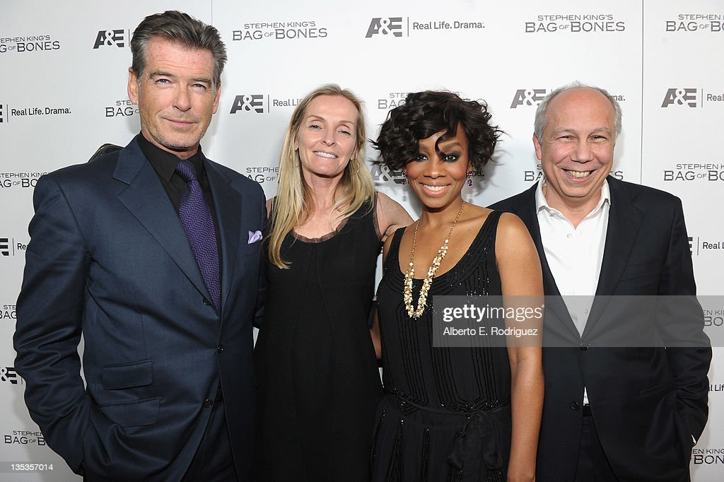 Actor Pierce Brosnan, A&E VP of Drama Programing Tana Jamieson, actress Anika Noni Rose and A&E President and GM Bob DeBitetto attend A&E's premiere party event for Stephen King's 'Bag of Bones' at Fig & Olive Melrose Place on December 8, 2011 in West Hollywood, California.